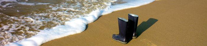 Stiefel am Strand